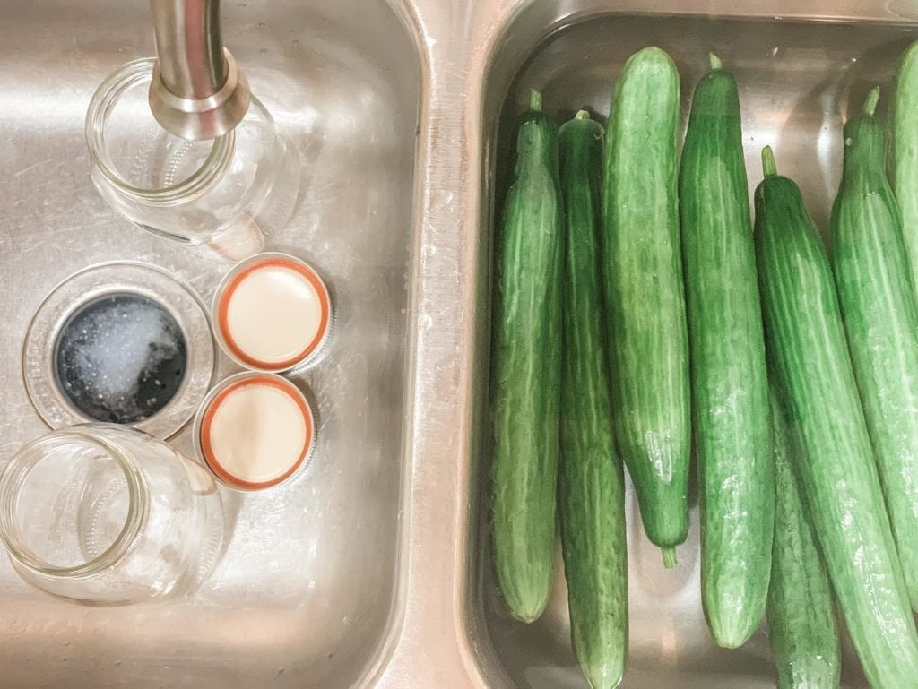 cucumbers washing in sink for Homemade QUICK Refrigerator Pickles