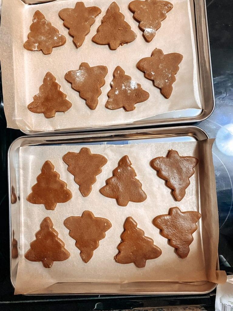 unbaked vegan gingerbread cookies on prepared sheets