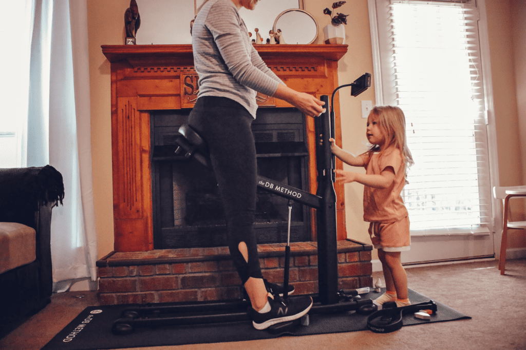 working out with The DB Method while entertaining a toddler